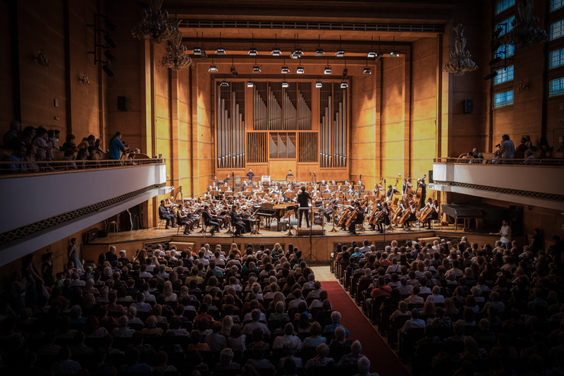 A symphony orchestra performing in a concert hall