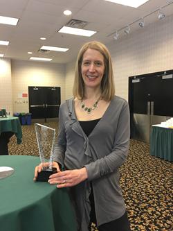 Kim Frail with Award