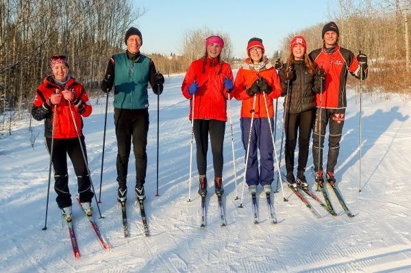 6 people in the Camrose Valley ready to head out for a cross-country ski on a bright winter day