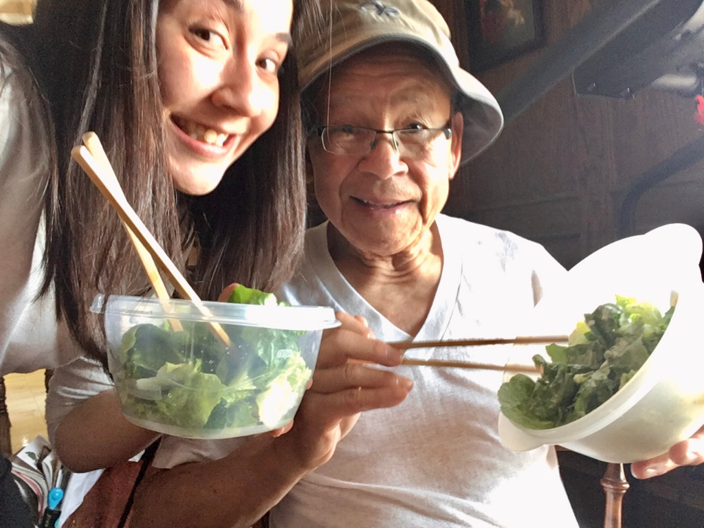 Junelle and Jun eating salad with chopsticks.