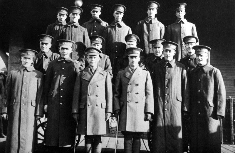 Three rows of soldiers stand facing the camera.