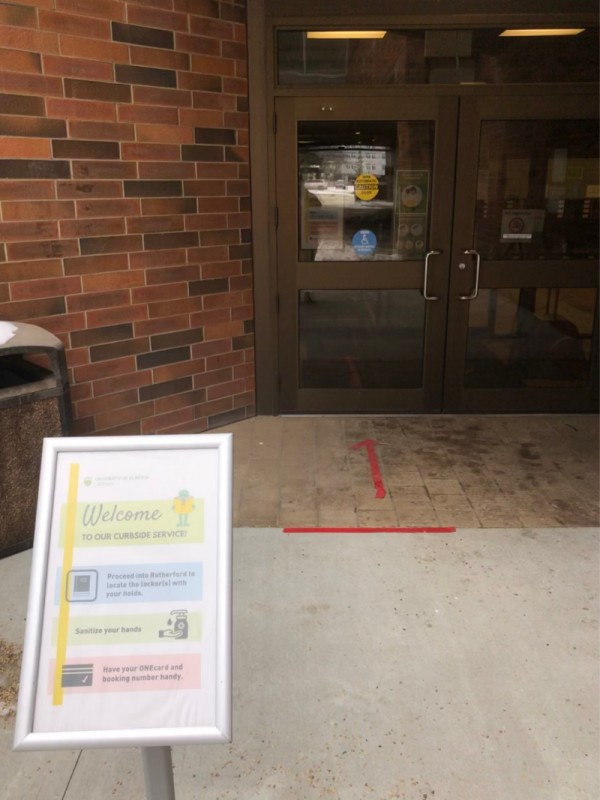 East doors to enter Rutherford with instructional sign
