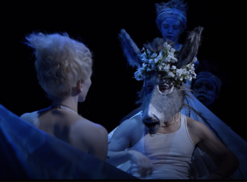 A scene of a horse with a human body speaking to a woman.